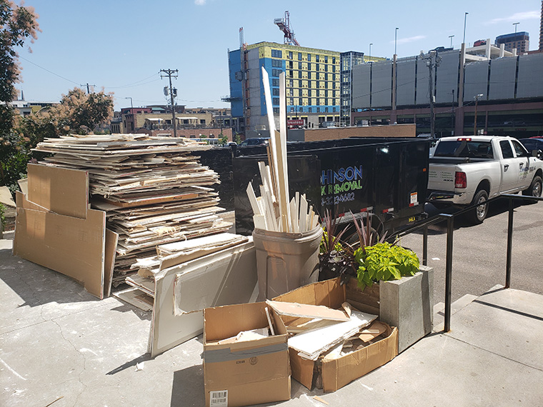 Providing commercial junk removal services for a commercial client