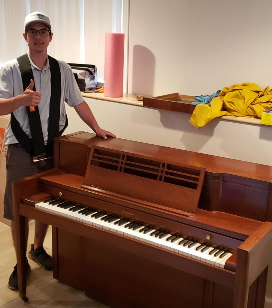 Piano removal by a Johnson Junk Removal expert