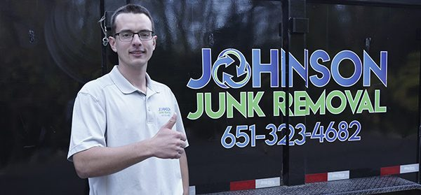 Junk removal expert holding a thumbs up sign