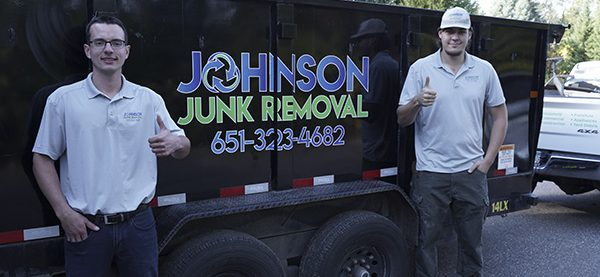 Junk removal professionals in front of their truck