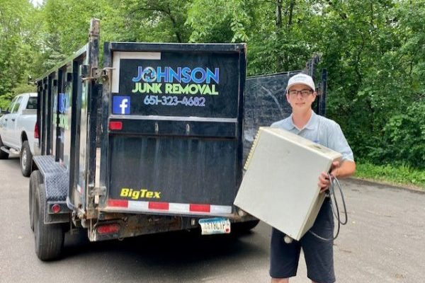 Junk removal professional hauling appliances